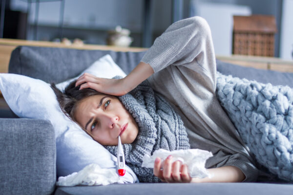Sick female with cold and flu